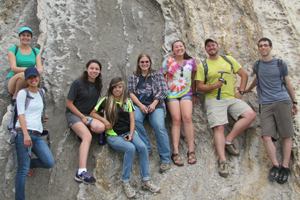 eight undergraduate students by rock outcrop