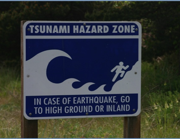 A tsunami warning sign from the coast of Washington state.  Credit: West, N.  2013.