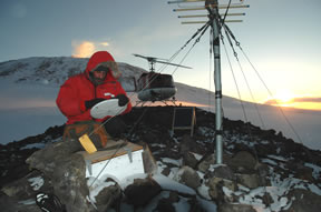 Figure 3 - Jim Greenberg retrieves a receiver from Abbott Peak, after an Antarctic winter at an extremely exposed location.
