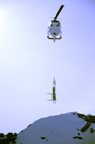 Figure 6 - Solar frame, antenna and a section of tower being dropped off for the CONZ repeater site on Mt Erebus.