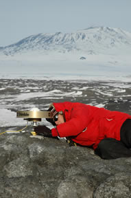 Figure 7 - Beth setting up a TAMDEF campaign site at Cape Royds which is also useful for the Erebus network.