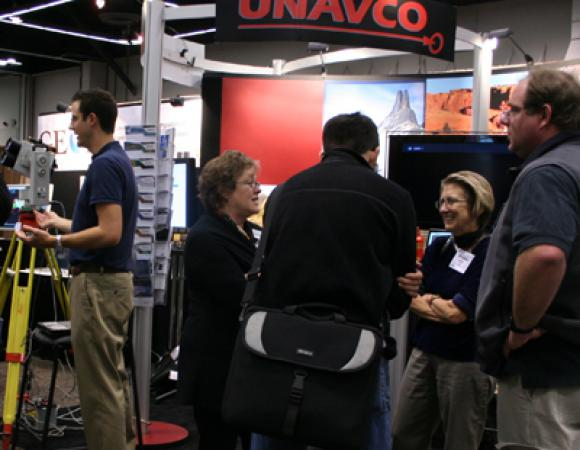 UNAVCO President Meghan Miller (right) chats with staff and community members at the UNAVCO booth at the AGU Fall meeting, 2008. Alex Biholar (left) of University of Texas at Dallas gives a presentation on LiDAR scanning.