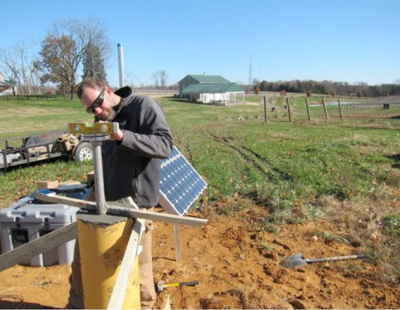 UNAVCO engineer Dave Kasmer levels the SCIGN mount on VA01.