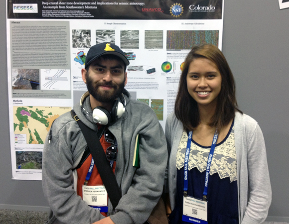 The RESESS program was heavily represented at AGU. Here 2005, -06, -08, and -09 RESESS alumnus Stephen Hernández and first-year 2013 intern Diana Rattanasith stand in front of the poster produced by Rattanasith about her research on seismic anisotropy in deep crustal sheer zones. Photo by Aisha Morris.