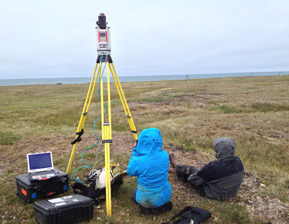 ITEX researchers assist with terrestrial LiDAR scanning at Chukchi coast thermokarst site near Barrow, Alaska. Photo provided by Brendan Hodge.