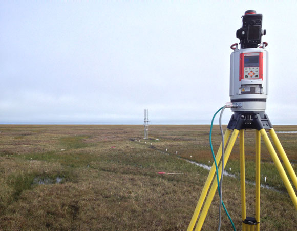 During a short pause in rain, a UNAVCO terrestrial laser scanner operates at the Barrow ITEX NIMS site. Photo provided by Brendan Hodge.