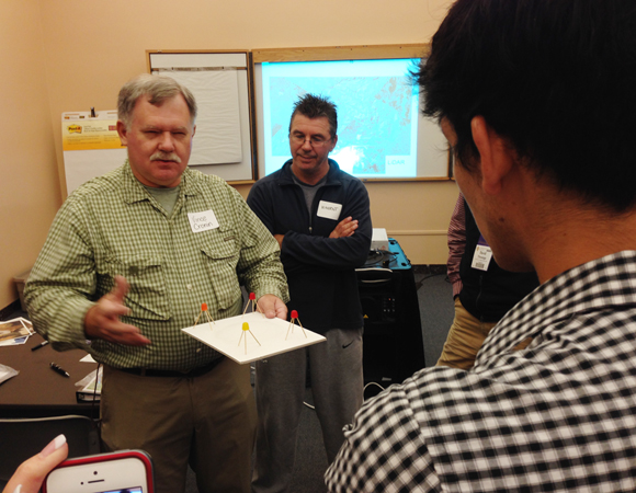 Vince Cronin of Baylor University teaches science educators about geodesy at a GSA short course led by UNAVCO Education Specialist Shelley Olds before the 125th Anniversary annual GSA meeting in Denver, Colorado.  The course was entitled Yellowstone National Park as a Hotbed for Inquiry—For Teachers. For more, see http://community.geosociety.org/2013AnnualMeeting/conference/courses. Photo by Shelley Olds.