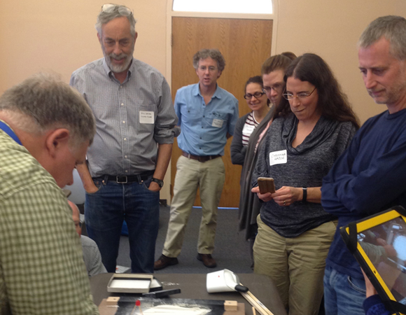 UNAVCO-led GSA short course attendees learn about geodetic teaching tools in Integrating GPS, LiDAR, InSAR, and Other Geodesy Data into Undergraduate Courses at the GSA annual meeting in Denver, Colorado on Saturday, Oct. 26, 2013. Faculty members were introduced to a range of existing teaching materials that feature geodesy data in earth science learning. Each of the 11 participants said it was a valuable educational experience and recommended that the course be repeated at the next GSA. Photo by Beth Pratt-Sitaula.