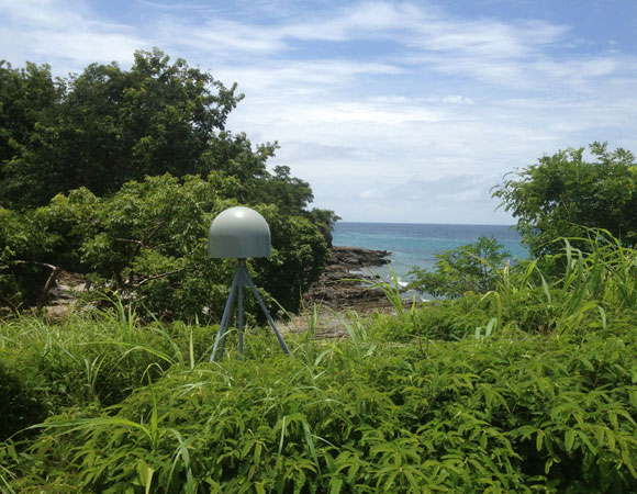 COCONet GPS site CN28 on Contadora Island. Just beyond the site, the land drops away to the Pacific ocean. Photo provided by Mike Fend.
