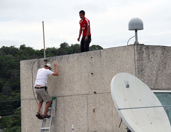 Last climb down the wall. Antenna and met pack installed. Photo provided by Jim Normandeau.