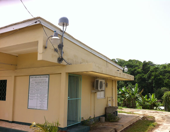 The GPS antenna at TOCO is installed on the roof of the local health center.  The building is one of very few reinforced concrete structures in the sparsely populated northeast corner of Trinidad. Photo by Sarah Doelger.