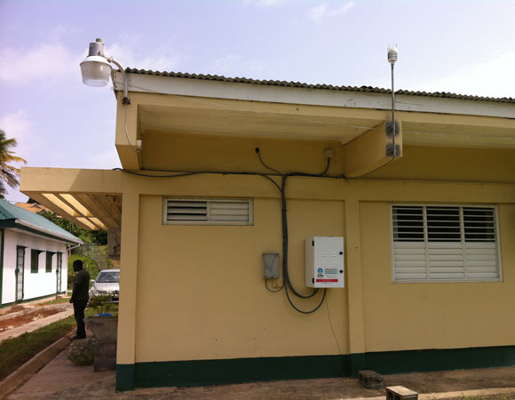 The electronics enclosure and meteorological instrument are located approximately 50 feet away from the antenna on the back side of the health center. Photo by Sarah Doelger.