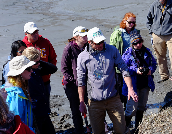 USGS Geologist Rob Witter describes how a ghost forest is formed and sands are deposited during a tsunami. Photo by Shelley Olds.
