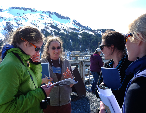 Workshop participants discuss the tsunamis that struck the town of Whittier, Alaska after the 1964 Great Alaska Earthquake. Whittier is located off Prince William Sound at the end of Passage Canal. Photo by Shelley Olds.