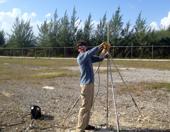 UNAVCO field engineer Jacob Sklar welds the GPS antenna monument for CN13 on San Salvador Island, Bahamas. Photo by John Sandru, UNAVCO.
