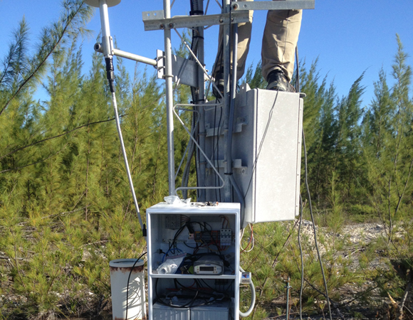 The instumentaion and power enclosure on a tower for CN14 on Great Inagua, Bahamas. Photo by John Sandru, UNAVCO.