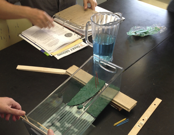 A tsunami wave tank allows students and informal learners to investigate the properties that affect tsunami inundation. Photo by Beth Pratt-Sitaula (UNAVCO, CWU).