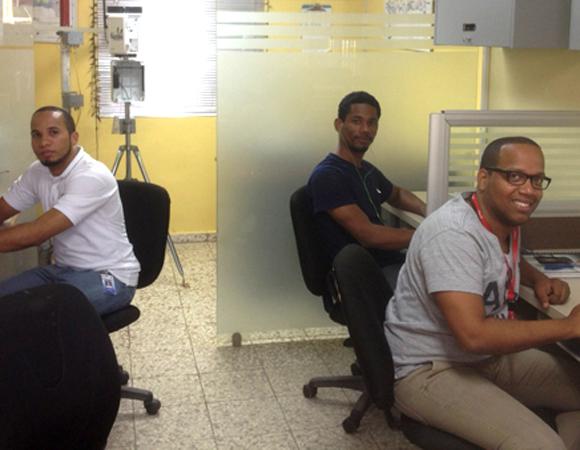 In the ONAMET site monitoring room: Roldan Avila, Edgar Ulerio, and Javier Acosta. Photo by Mike Fend.