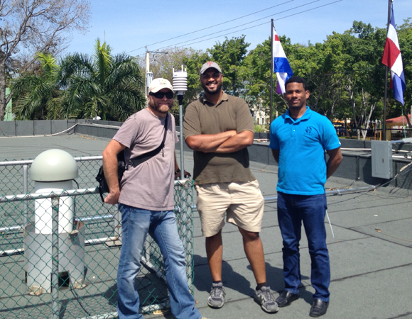 UNAVCO COCONet engineer John Sandru, left, with Juan Salado and Edgar Ulerio of ONAMET at site SROD. Photo provided by John Sandru.