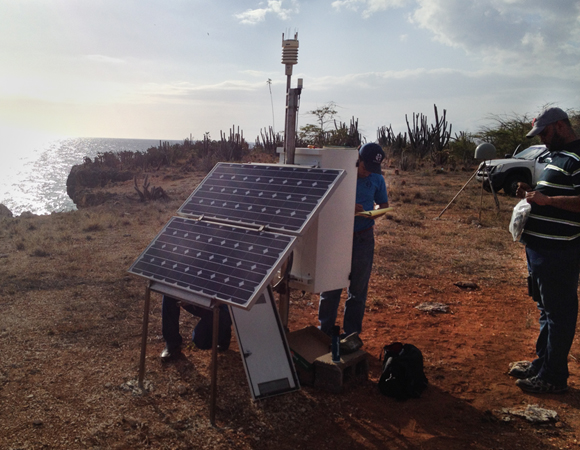 Working on the solar panels at site CN08. Photo by John Sandru.