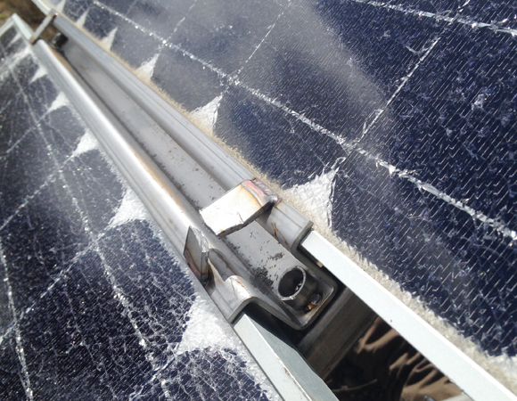 Damage to the solar panels at site CN06. Photo by John Sandru.
