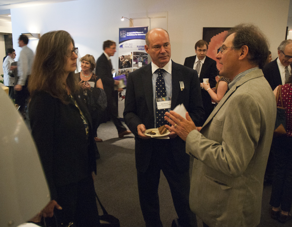 Glen Mattioli, Director of Geodetic Infrastructure at UNAVCO (right), speaks with National Geodetic Survey director Juliana Blackwell and deputy director Neil Westin at the post-symposium EarthScope reception. (Photo/Beth Bartel, UNAVCO)