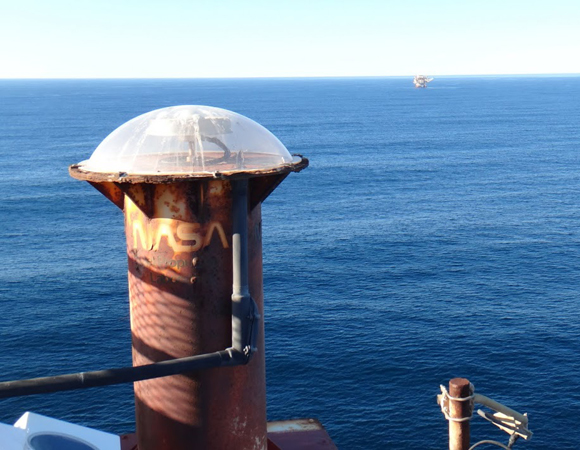 The GPS antenna, under a protective radome, at the Harvest oil platform. Photo by Andrea Prantner.
