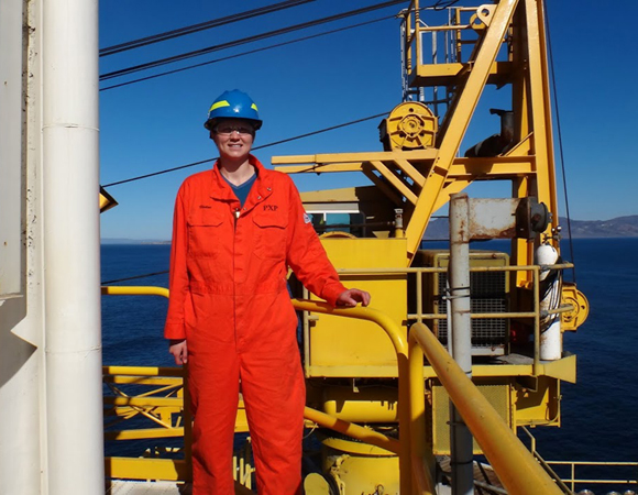 UNAVCO engineer Andrea Prantner decked out in safety gear at the Harvest oil platform. Photo provided by Andrea Prantner.