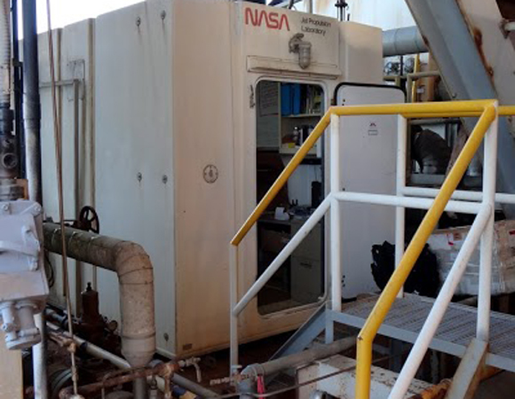 A hut housing NASA instrumentation used to calibrate the long-term altimetric record of global sea level. Photo by Andrea Prantner.