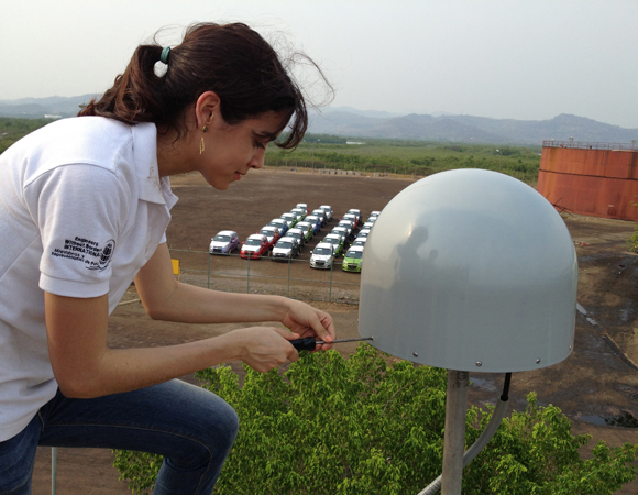 Patricia Eveline, a UPI computer science student, helps finalize the installation of CN21. Photo by Michael Fend.