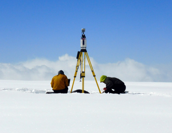 UNAVCO engineer Brendan Hodge and University of Maine student Dan Bradford quickly set up a terrestrial LiDAR scanner (TLS) to survey the glacier on Mount Hunter between storms.  Photo by Patrick Saylor, Dartmouth.
