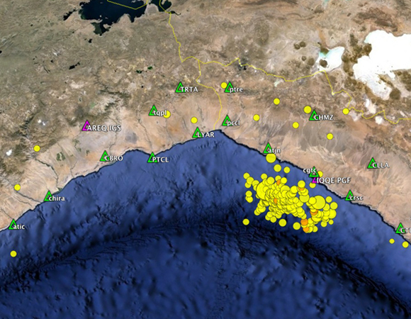 Map showing the locations of 25 Caltech-built continuous GPS stations in northern Chile and southern Peru (green triangles) and IGS stations AREQ and IQQE (magenta triangles), as well as the USGS magnitude +2.5 earthquakes from March 7 - April 7, 2014. (Figure provided by John Galetzka, UNAVCO.)