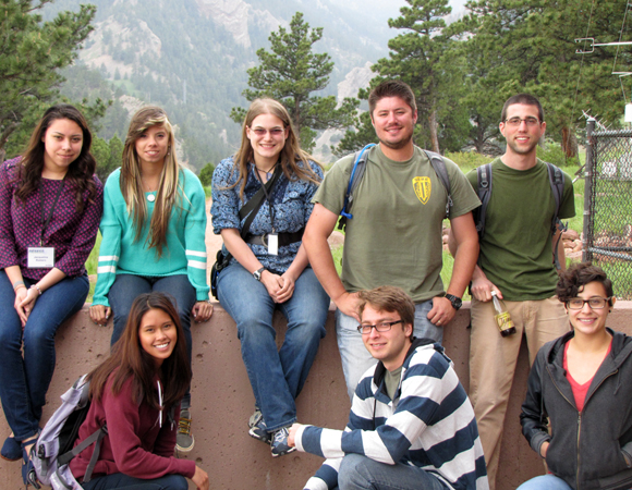 Taking a break on lab tour day. RESESS interns joined SOARS and NEON interns on tours of UNAVCO, NEON, and NCAR. Pictured here at the NCAR Mesa Lab, from top left to bottom right: Jacqueline Romero, Ashlyann Arana Morales, Ann Marie Prue, Wesley Weisberg, Joshua Russell, Diana Rattanasith, Garth Ornelas, and Belinda Gonzalez. (Photo by Melissa Weber, UNAVCO.)