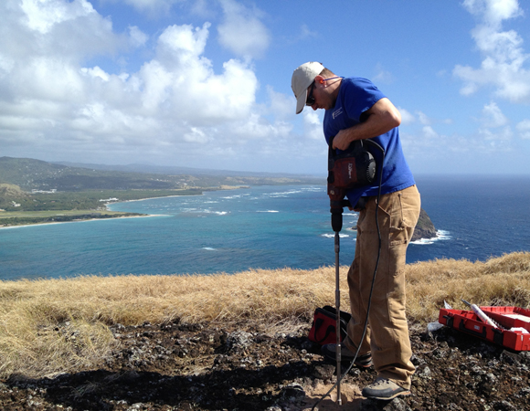 UNAVCO COCONet field engineer Mike Fend drills the center hole for the CN47 GPS monument. Photo by Jacob Sklar.