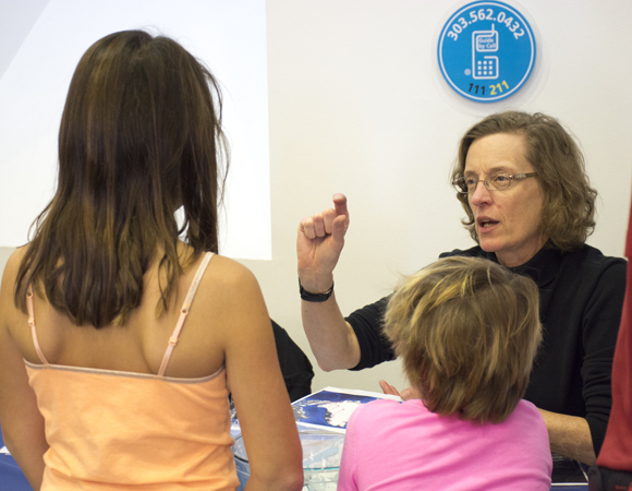Geodetic Data Services project manager Fran Boler explains how we use GPS to measure small changes in the shape of the Earth to kids at Super Science Saturday. Photo by Beth Bartel, UNAVCO.