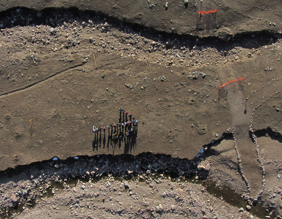 The effects of flooding, a geeky crowd, and a TLS instrument from above, complements of structure from motion on the 2014 UNAVCO Science Workshop field trip to the mouth of Fourmile Canyon. (Photo/Kendra Johnson, Colorado School of Mines)