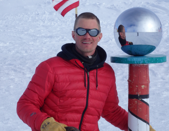 UNAVCO Engineer Ryan Bierma at the South Pole. Ryan traded winter in Alaska for a summer in Antarctica in 2013.