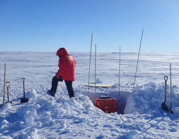Washington University Research Scientist Patrick Shore finishes unburying the equipment box from snow at seismic station ALYS.