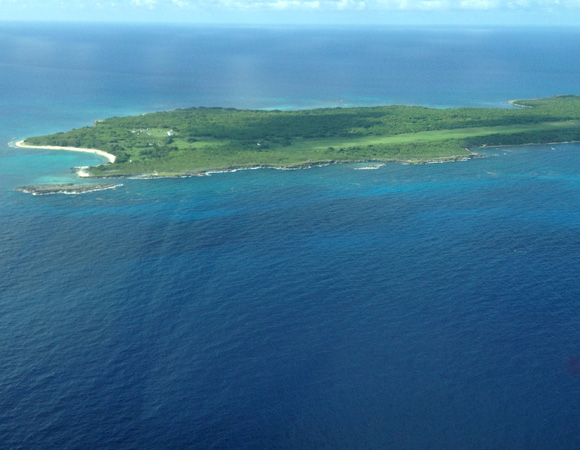 An aerial view of Swan Island, Honduras, where cGPS site CN18 is installed. Photo by Michael Fend, UNAVCO.