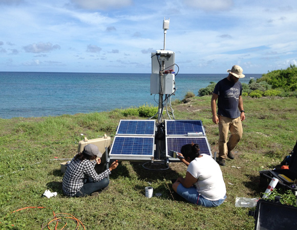 Local engineering students from UPI assisted with the installation of cGPS site CN18 on Swan Island, Honduras. From left: Nancy Mazarigos (UPI), Marissa Garcia (UPI), and John Sandru (UNAVCO). Photo by Michael Fend, UNAVCO.