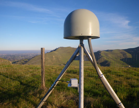 EarthScope Plate Boundary Observatory station P248, Black Diamond, with an accelerometer mounted on the center post of the GPS antenna monument. (Photo by Doerte Mann, UNAVCO)