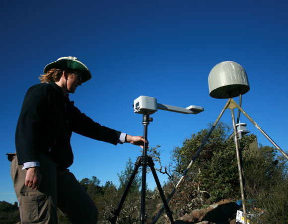 PBO field engineer Doerte Mann uses a GPS-based compass, on loan from Scripps, to align the accelerometer to north at P201. (Photo by Christian Walls, UNAVCO)