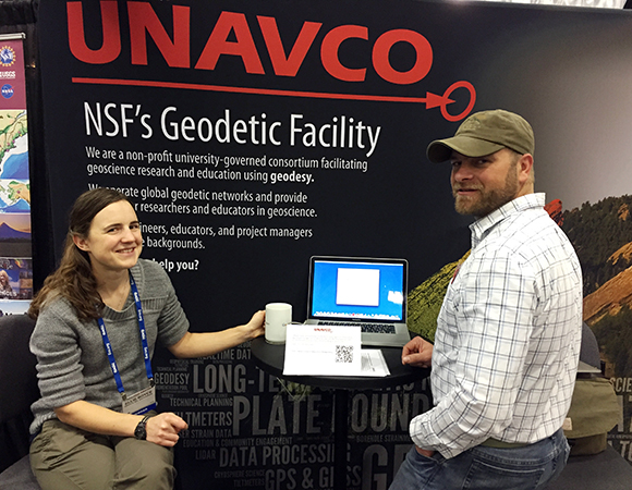 UNAVCO field engineers Ellie Boyce and John Sandru staffing the UNAVCO booth at AGU 2014. (Photo/Aisha Morris, UNAVCO)