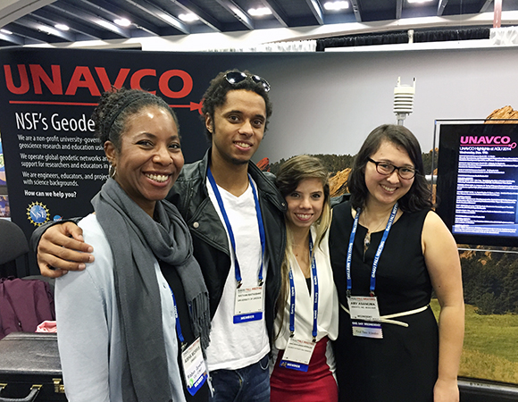 UNAVCO RESESS director Aisha Morris reuniting with RESESS interns at the UNAVCO booth at AGU 2014.