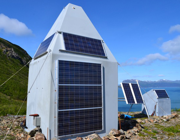 PBO station AC59 with new solar panels on the large hut and swingset. (Photo/UNAVCO)