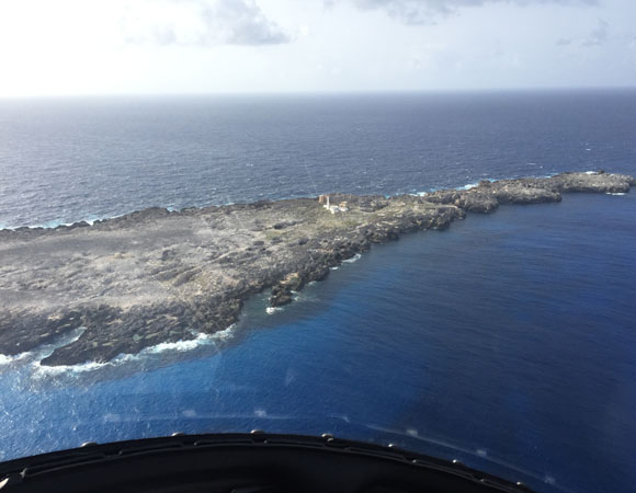 Sombrero Island, Anguilla, home of COCONet station CN51. The uninhabited island once housed several lighthouses and was mined for phosphate. (Photo/John Sandru, UNAVCO)