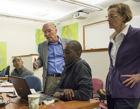 Stuart Wier and Fran Boler of UNAVCO work with Daison Lowe and Wayne Depradine, both from CIMH Barbados, to run Dataworks software at a Dataworks training class at the UNAVCO Boulder facility in December 2014. (Photo/Beth Bartel, UNAVCO)