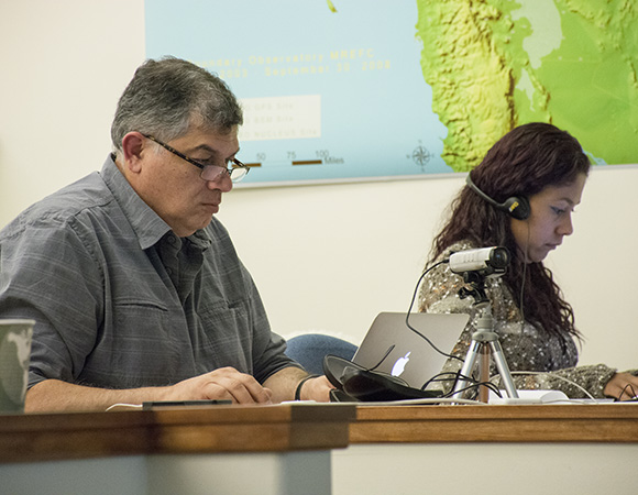 Enrique Cabral-Cano of UNAM and Leidy Giraldo of SGC learn how to run Dataworks for their Regional Data Centers at the Dataworks training class at the UNAVCO Boulder facility in December 2014. (Photo/Beth Bartel, UNAVCO)