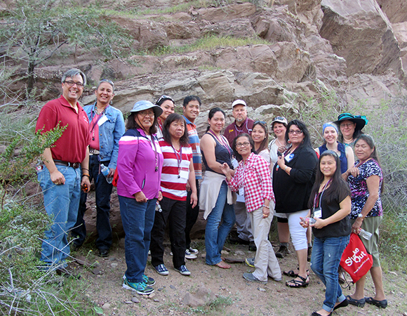 Native Science Educators Workshop participants and facilitators study the local geology of Tempe, AZ. (Photo/Diana Dalbotten)