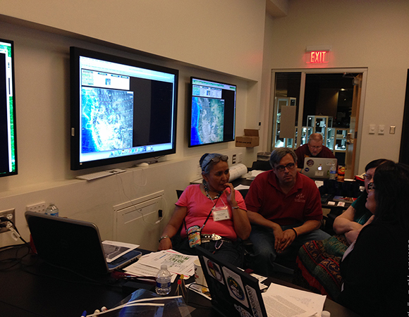Teachers learn about earthquake distribution and frequency in the Western United States at the Southwest Native Science Educators Workshop held at the EarthScope National Office, Arizona State University, Tempe, Arizona, March 15, 2015. (Photo/Shelley E. Olds, UNAVCO)